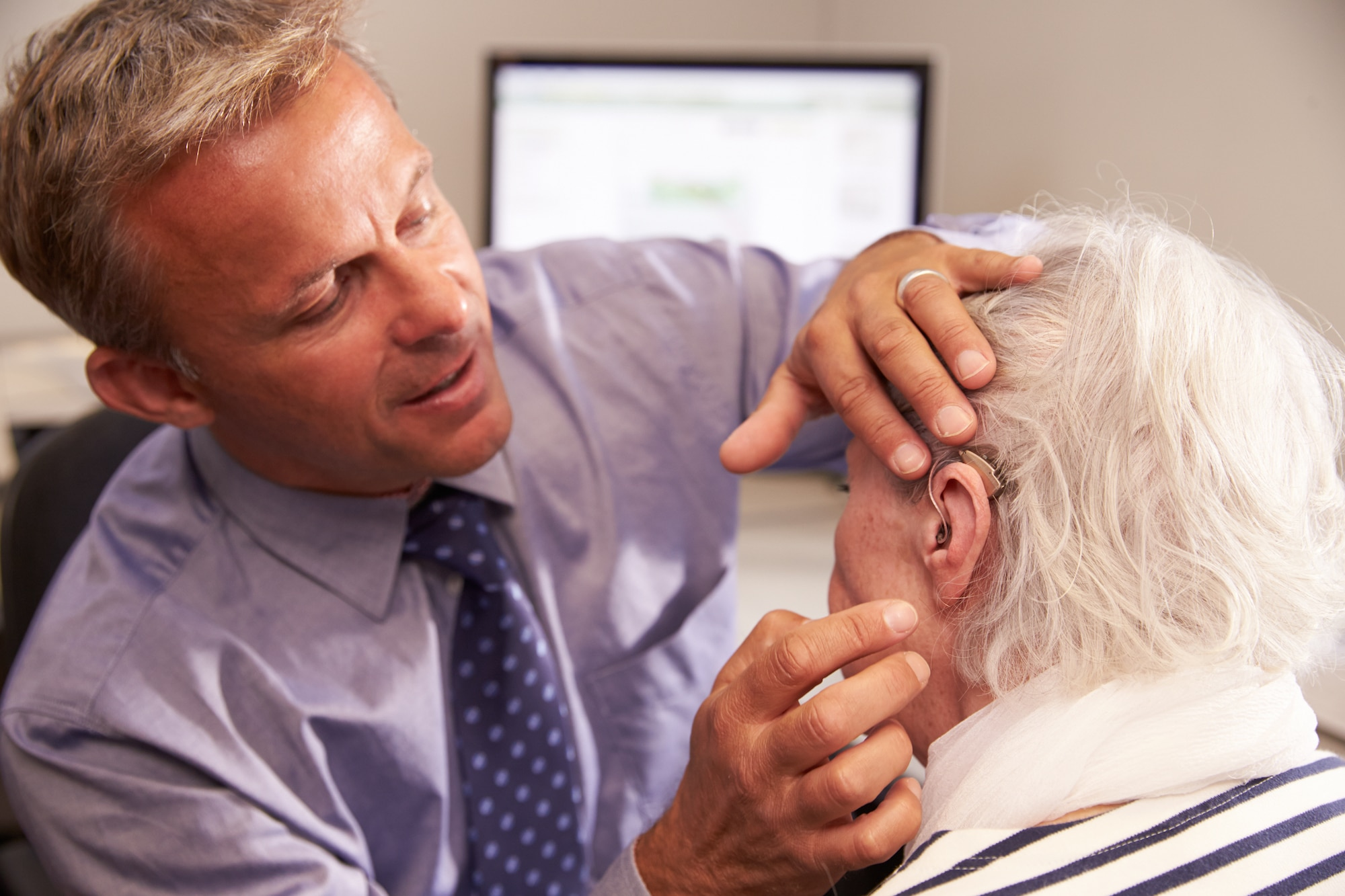 man having his hearing aid fit