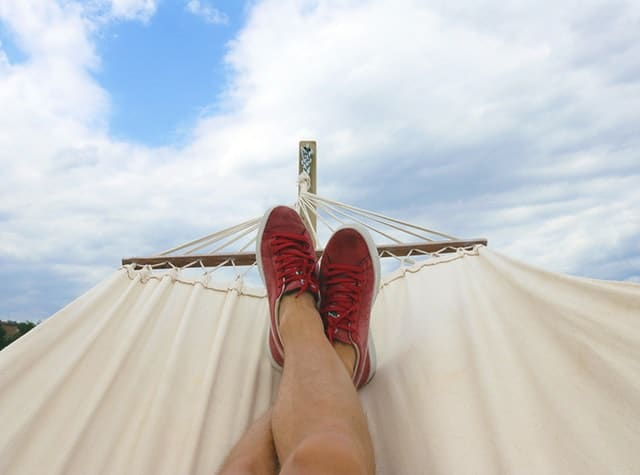 person's feet in a hammock
