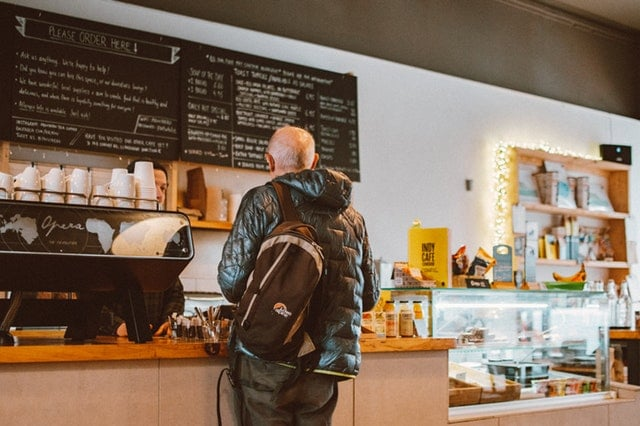 Man standing at a coffee counter