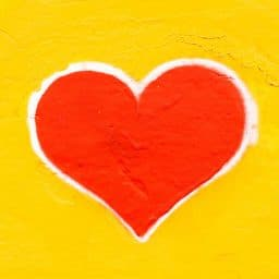 A red heart on a yellow background.